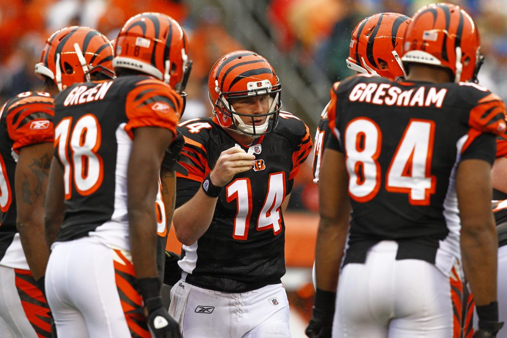 CINCINNATI, OH - NOVEMBER 27:  Andy Dalton #14 of the Cincinnati Bengals talks with his team in between plays during the game against the Cleveland Browns at Paul Brown Stadium on November 27, 2011 in Cincinnati, Ohio.  (Photo by Tyler Barrick /Getty Images)